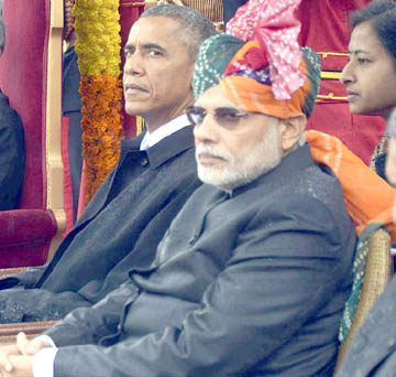 India's PM Modi, US President Obama, India's President Mukherjee and Vice President Ansari sit as they attend the Republic Day parade in New Delhi
